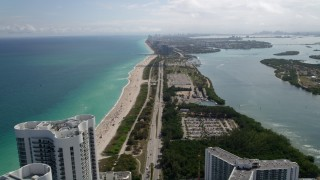 AX0020_088 - 5K stock footage aerial video of fly over Trump Towers high-rise by the beach toward Bal Harbour, Florida