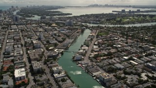 AX0020_097 - 5K stock footage aerial video of waterfront property on a canal through Miami Beach, Florida