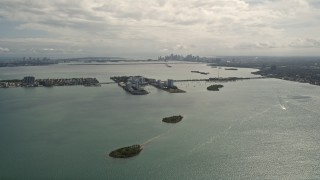 AX0020_101 - 5K stock footage aerial video of small island with waterfront homes in Biscayne Bay, Florida