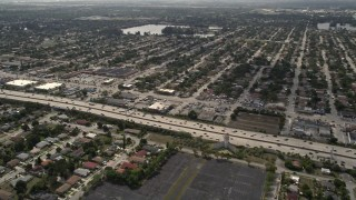 AX0020_107 - 5K stock footage aerial video of light traffic on Interstate 95 through Miami Shores, Florida