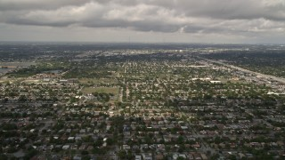 AX0020_108 - 5K stock footage aerial video of flyby suburban neighborhoods in Miami Shores, Florida