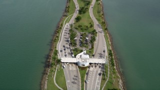 AX0021_009 - 5K stock footage aerial video fly over the Broad Causeway and tilt to toll booths in North Miami, Florida