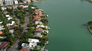 AX0021_013 - 5K stock footage aerial video fly over waterfront homes on Bay Harbor Islands, Florida