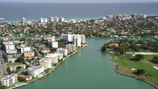AX0021_014 - 5K stock footage aerial video approach waterfront apartment buildings on Bay Harbor Islands and Surfside neighborhoods, Florida