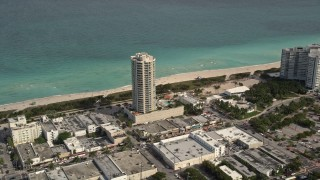 AX0021_021 - 5K stock footage aerial video of beachfront condominium complex in Miami Beach, Florida