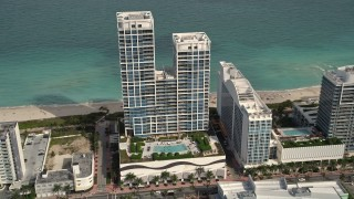 AX0021_022E - 5K stock footage aerial video of an oceanfront hotel in Miami Beach, Florida