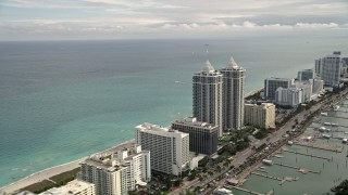 AX0021_028E - 5K stock footage aerial video of oceanfront hotels and condominiums in the coastal city of Miami Beach, Florida