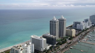 AX0021_029 - 5K stock footage aerial video of beachfront hotels by the Blue and Green Diamonds in Miami Beach, Florida