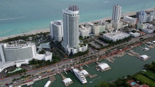 AX0021_031 - Aerial stock footage of 5K aerial  video of oceanfront resort hotel by the beach in Miami Beach, Florida