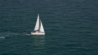 AX0021_041 - 5K stock footage aerial video of catamaran sailing on the blue ocean near South Beach, Florida