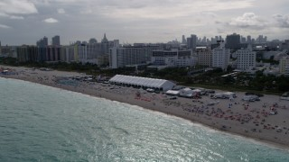 AX0021_053 - 5K stock footage aerial video of beachgoers and hotels with ocean views in Miami Beach, Florida