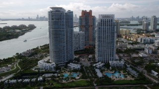 AX0021_060 - 5K stock footage aerial video of two modern skyscrapers near the ocean in South Beach, Florida