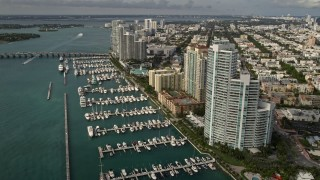 AX0021_062 - 5K stock footage aerial video of waterfront residential skyscrapers and a marina in South Beach, Florida