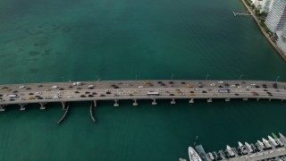 AX0021_063 - 5K stock footage aerial video of slow traffic on the MacArthur Causeway on the shore of South Beach, Florida