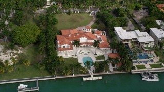 AX0021_070 - 5K stock footage aerial video of a spacious mansion with a bay view on Star Island, Florida