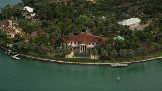 AX0021_072E - 5K stock footage aerial video of a bayfront island estate on Star Island, Florida