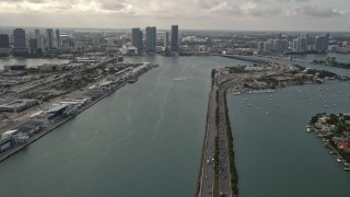 AX0021_076 - 5K stock footage aerial video tilt from MacArthur Causeway to reveal Downtown Miami skyscrapers in Florida