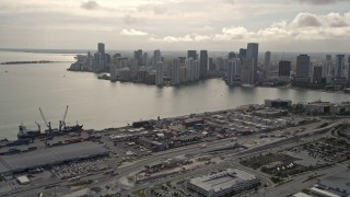 AX0021_077 - 5K stock footage aerial video of Downtown Miami skyline seen from the Port of Miami, Florida