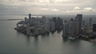 AX0021_078E - 5K stock footage aerial video tilt from Port of Miami to reveal and approach Downtown Miami, Florida