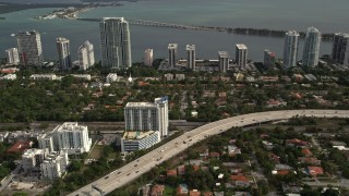 AX0021_084 - 5K stock footage aerial video of Interstate 95 near waterfront condos in Downtown Miami, Florida