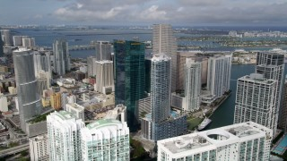 AX0021_090 - 5K stock footage aerial video fly over modern towers to approach Epic Hotel in Downtown Miami, Florida