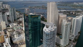 AX0021_091 - 5K stock footage aerial video fly over hotel and high-rise tower to approach Southeast Financial Center in Downtown Miami, Florida