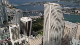 AX0021_092 - 5K stock footage aerial video fly over skyscrapers to reveal fountain at Bayfront Park in Downtown Miami, Florida