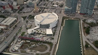 AX0021_095 - Aerial stock footage of 5K aerial  video orbit of American Airlines Arena on the waterfront of Downtown Miami, Florida
