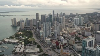 AX0021_096E - 5K stock footage aerial video pan from four skyscrapers to reveal and approach Downtown Miami high-rises, Florida