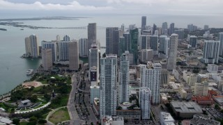 AX0021_098 - 5K stock footage aerial video of slow approach to skyscrapers and Bayfront Park in Downtown Miami, Florida