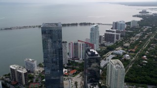 AX0021_106 - 5K stock footage aerial video flyby Four Seasons Hotel to approach high-rise condos in Downtown Miami, Florida