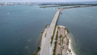 AX0021_110 - 5K stock footage aerial video of light traffic on a rise in the Rickenbacker Causeway in Miami, Florida