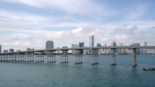 AX0021_114 - 5K stock footage aerial video of Downtown Miami skyline behind the Rickenbacker Causeway, Florida