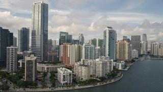 AX0021_117E - 5K stock footage aerial video tilt to reveal skyline of Downtown Miami, Florida
