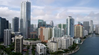 AX0021_118 - 5K stock footage aerial video approach Four Seasons Hotel high-rise from shore in Downtown Miami, Florida