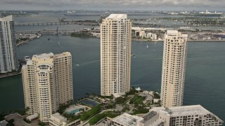 AX0021_122 - 5K stock footage aerial video of waterfront skyscrapers on the shore of Brickell Key, Downtown Miami, Florida