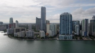 AX0021_124 - 5K stock footage aerial video of coastal city waterfront skyscrapers in Downtown Miami, Florida