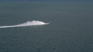 AX0021_153 - 5K stock footage aerial video track a sport boat racing across Biscayne Bay, Florida