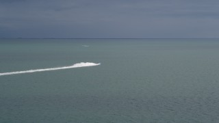 AX0021_157 - 5K stock footage aerial video track a sport boat as it races across Biscayne Bay, Florida