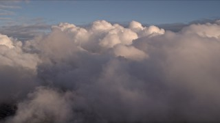 AX0022_003 - 5K stock footage aerial video approach thick cloud cover at sunset over Miami, Florida