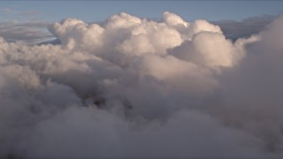 AX0022_004E - 5K stock footage aerial video approach thick bank of clouds over Miami at sunset in Florida