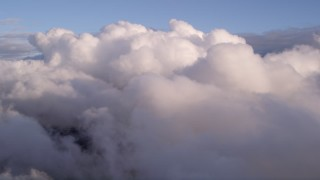 AX0022_006 - 5K stock footage aerial video approach a thick cloud bank at sunset in Miami, Florida
