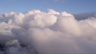 AX0022_007 - 5K stock footage aerial video of thick cloud cover at sunset over Miami, Florida
