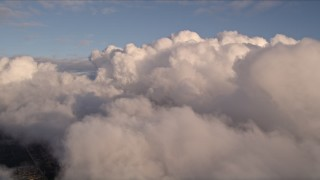 AX0022_008E - 5K stock footage aerial video approach thick cloud formation over Miami at sunset, Florida