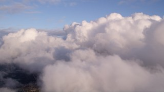 AX0022_009 - 5K stock footage aerial video pan across thick bank of clouds at sunset over Miami, Florida