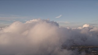 AX0022_011 - 5K stock footage aerial video of a thick formation of clouds over Miami at sunset, Florida