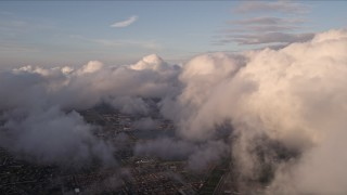 AX0022_013E - 5K stock footage aerial video pan across cloud formation at sunset over Miami, Florida