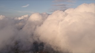 AX0022_015 - 5K stock footage aerial video approach cloud formation over Miami at sunset, Florida