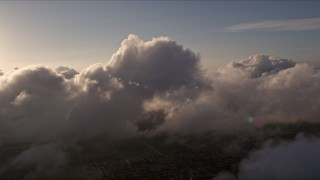 AX0022_016 - 5K stock footage aerial video of dense clouds over Miami at sunset, Florida