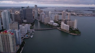 AX0022_044 - 5K stock footage aerial video approach the bridge linking Downtown Miami with Brickell Key at sunset, Florida